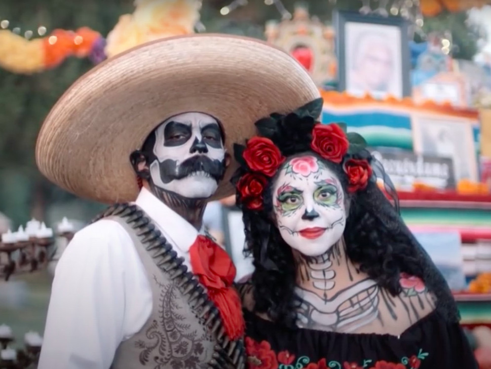 Festival of the Dead in the World of the Living- a couple dressed up and painted for the celebration
